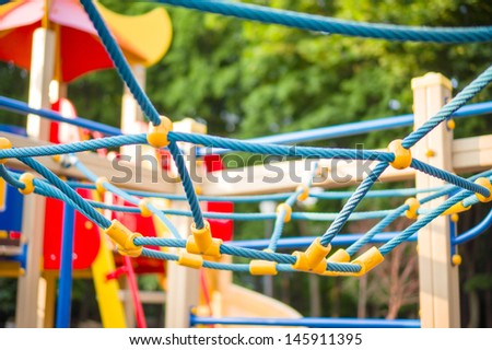 Blue spider net construction on kids playground - stock photo