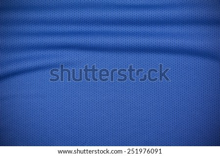 Blue sport jersey shirt clothing texture and background - stock photo