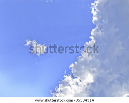 Blue Spring Sky with Fluffy Clouds - stock photo