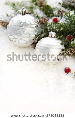 Blue spruce in snow and Christmas decorations - stock photo