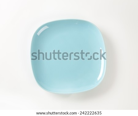 blue square plate on white background - stock photo