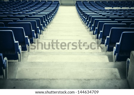 Blue stadium seats in a rear view. - stock photo