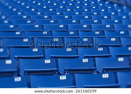Blue stadium seats (selective focus) - stock photo