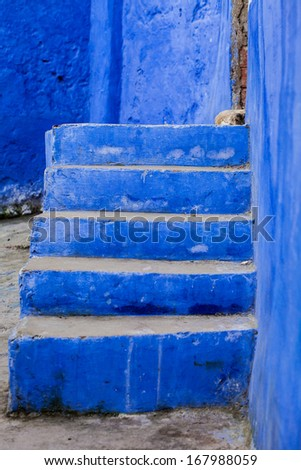 Blue staircase leading to the entrance of the house - stock photo