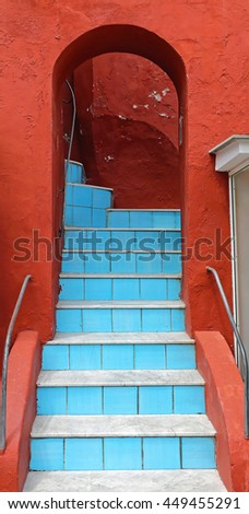 Blue Stairs at Red Building With Arch Way - stock photo