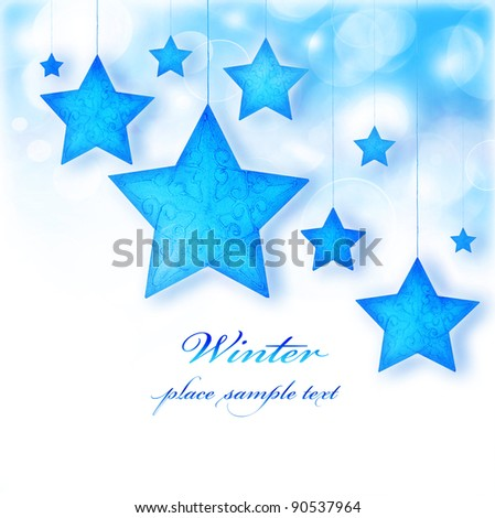Blue stars, Christmas tree ornaments and holiday decorations, winter border with bokeh lights and white text space - stock photo