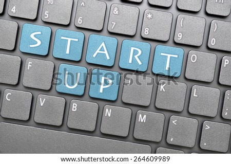 Blue start up key on keyboard - stock photo
