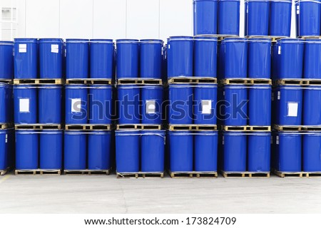 Blue steel barrels with liquid material for factory - stock photo