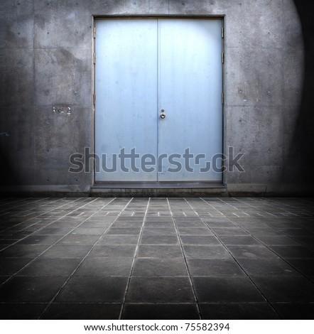 Blue steel door and concrete surrounding. - stock photo