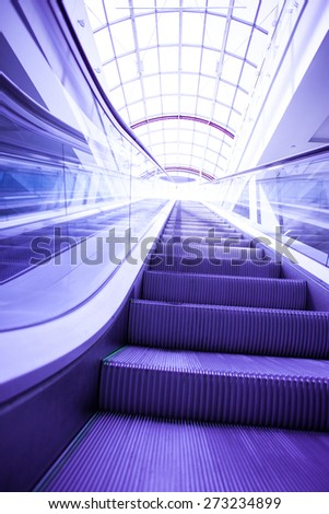 blue steps of escalator in office center - stock photo