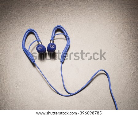 Blue stereo ear phones/Ear Phones/Ear phones used for listening to music - stock photo