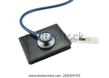 Blue stethoscope on wallet and digital thermometer isolated white background