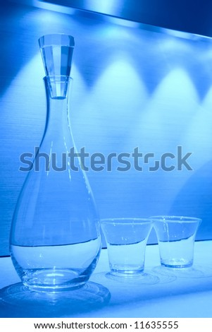 blue still life, glass carafe and two transparent glasses