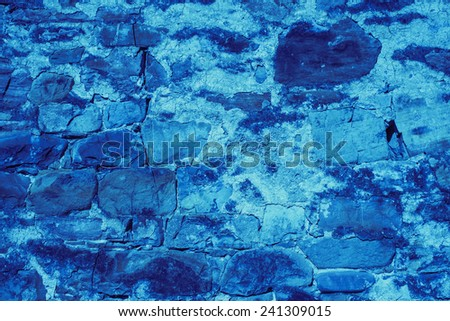 Blue stone wall texture background - stock photo