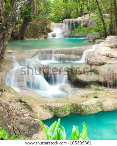 Blue stream waterfall in Kanjanaburi Thailand (Erawan National Park) - stock photo