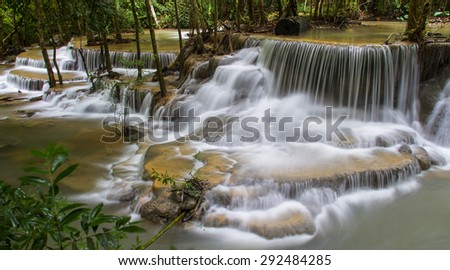 Blue stream waterfall in Kanjanaburi Thailand (huaymaekamin waterfall) - stock photo