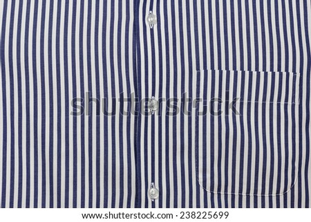 Blue stripe men's shirt texture with buttons and pocket; Close up - stock photo
