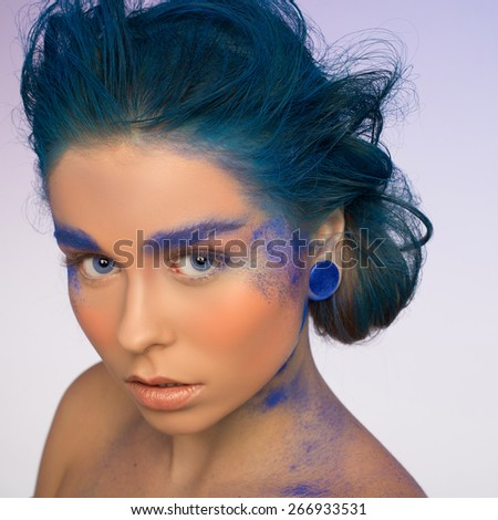 blue. studio. close up color woman face art .  - stock photo