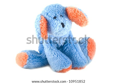 Blue stuffed animal with orange paws and ears on a white background. - stock photo