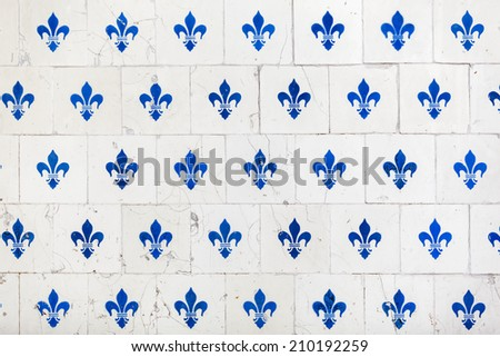 Blue stylized coat of arms azulejos on the building's exterior in Lisbon, Portugal. - stock photo