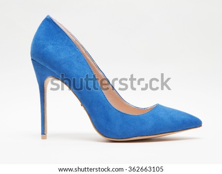 blue suede women shoe isolated with shadows - stock photo