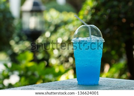 Blue  summer drinks with ice in glass - stock photo