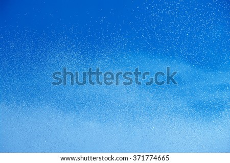 blue summer raindrops falling  - stock photo