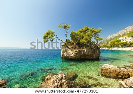 Blue summer sea with shiny sky and rocks, holiday tourism landscape