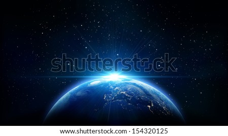 blue sunrise, view of earth from space - stock photo