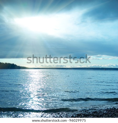 Blue sunset on the sea. Coastline and beautiful cloudscape. - stock photo