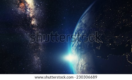 blue sunset, view of earth from space with milky way galaxy Elements of this image furnished by NASA - stock photo