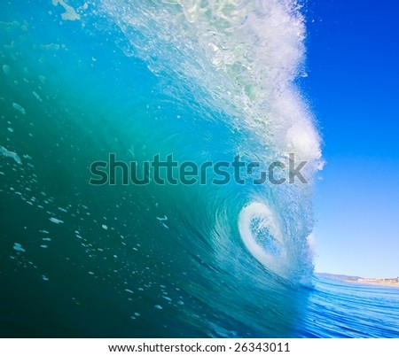 Blue Surfing Wave Breaks in Ocean, Epic Surf and Clear Sky - stock photo
