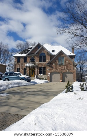 Blue SUV in front of the luxury house. - stock photo
