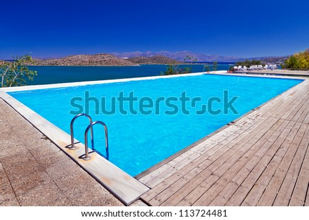 Blue swimming pool at Mirabello Bay in Greece - stock photo