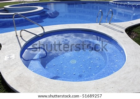blue swimming pool round shapes and outdoor jacuzzi
