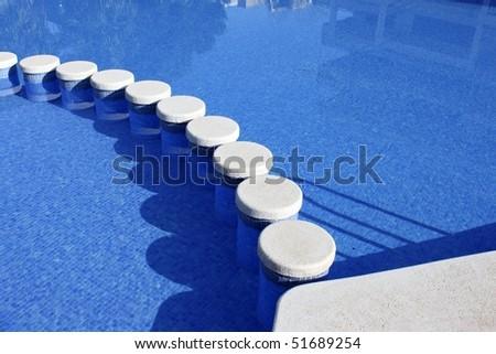 blue swimming pool round tiles crossing way summer vacation background - stock photo