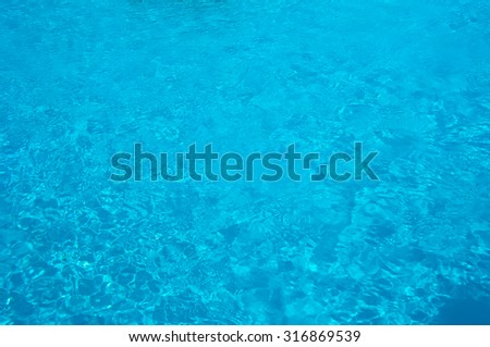 Blue swimming pool with clear water. Background - stock photo