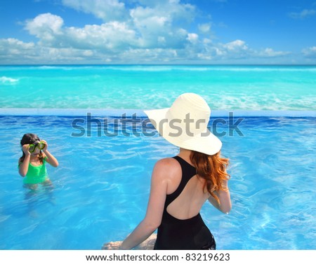 blue swimming pool with direct caribbean sea and rear mother view with goggles daughter [Photo Illustration] - stock photo