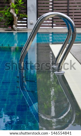 blue swimming pool with stair at hotel.