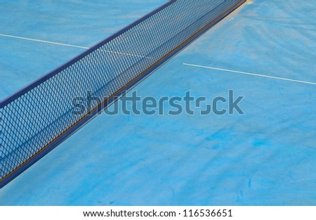 blue table tennis net with shadow - stock photo