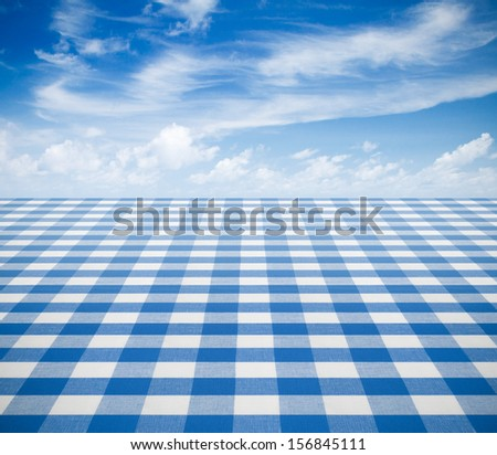 blue tablecloth backgound  with sky - stock photo