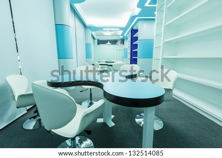 blue tables and white chairs in the empty library - stock photo