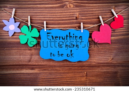 Blue Tag Or Label With Hearts And Flower And Four Leaf Clover On A Line With Life Quote Everything Is Going To Be Ok On Wooden Background, Four Symbols, Vintage, Retro And Old Fashion Style With Frame - stock photo