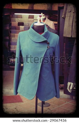 Blue tailored jacket hanging on a mannequin - vintage style.