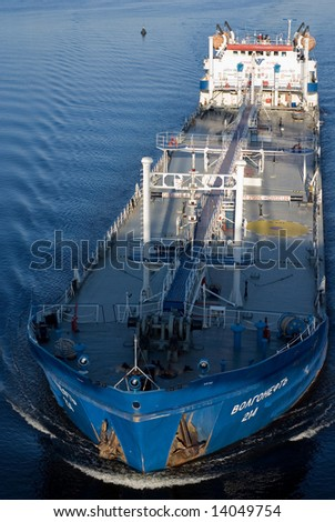 Blue tanker on the river - stock photo