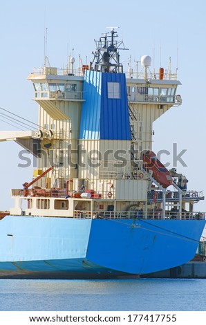 Blue tanker ship in dock.