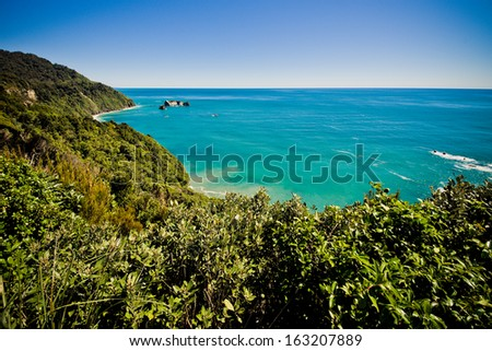 Blue Tasman Sea on West Coast of South Island in New Zealand - stock photo
