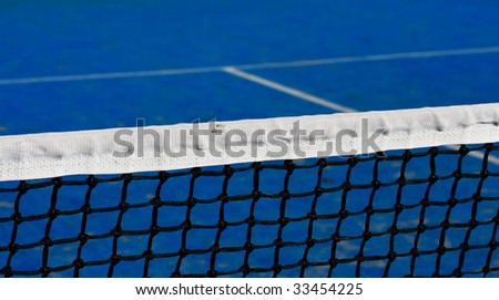 blue tennis court and net - stock photo