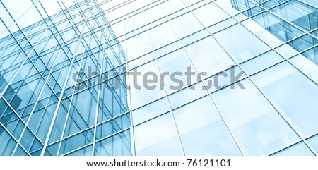 blue texture of glass transparent skyscrapers at night - stock photo