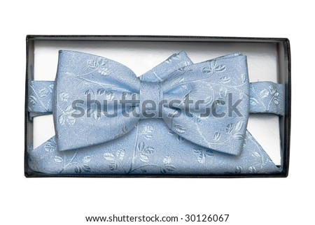 Blue tie-butterfly with patterns and a shawl in a gift box, it is isolated - stock photo